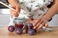 Preserving juicy plums Royalty Free Stock Photo