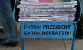 President Defeated, headlines on a Newspaper stack Royalty Free Stock Photo