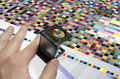 Press color management cmyk stripe loupe controll of the printed test chart patches for profile creation Stock Photos