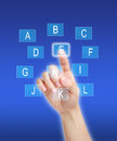Pressing on alphabet keys female finger blue background Stock Photos