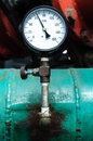 Pressure gauge on green pipe psig using Royalty Free Stock Photo