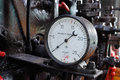 Pressure gauge old in a puffer Stock Photo
