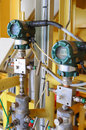 Pressure transmitter in oil and gas process send signal to controller and reading pressure the system Stock Photo