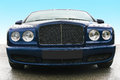 Prestige of car frontal blue on asphalt against the sky Royalty Free Stock Image