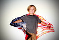 Preteen Boy with American Flag Royalty Free Stock Photo