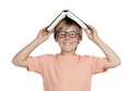 Preteen boy with a book and glasses isolated on white background Royalty Free Stock Images