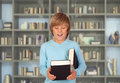 Preteen boy with books for reading in the library Royalty Free Stock Photo