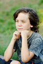 Preteen boy happy thoughtful with long hair Royalty Free Stock Image