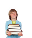 Preteen boy many books looking up isolated white background Royalty Free Stock Image