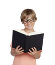 Preteen boy reading a book with glasses isolated on white background Royalty Free Stock Photos