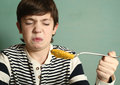 Preteen boy refuse to eat pumpkin soup Royalty Free Stock Photo