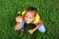 Preteen girl on clover Stock Photos