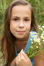 Preteen girl on grass background Stock Photo