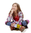 Preteen girl sitting cross-legged on the floor