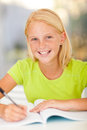 Preteen girl studying casual at home Stock Images