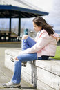 Preteen girl tying shoes outdoors Stock Photos