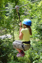 Preteen girl zipping down Stock Photography