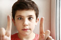 Preteen handsome boy play squinting trick Royalty Free Stock Photo