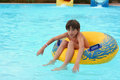 Preteen little boy in open air aqua park Royalty Free Stock Photo