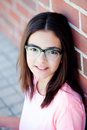 Preteenager girl next to a red brick wall Royalty Free Stock Photo