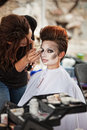 Pretty actress with eyeliner aesthetician working on circus outdoors Royalty Free Stock Photos