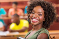 Pretty african college student portrait of in lecture room Stock Images