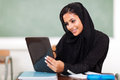 Pretty arabian teen girl using tablet computer high school classroom Royalty Free Stock Photos