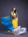 Pretty arabic dancer in yellow costume Royalty Free Stock Photo