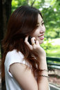 Pretty asia girl talking on the phone Royalty Free Stock Photo