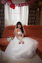 Pretty asian bride and bouquet Stock Photography