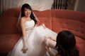 Pretty asian bride with garter Royalty Free Stock Photo