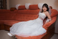 Pretty asian bride sit on sofa Royalty Free Stock Photos