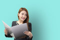 The pretty Asian business women open  the file Royalty Free Stock Photo