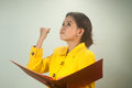 Pretty asian businesswoman complacent reading a file young in yellow suit Royalty Free Stock Image