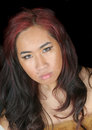 Pretty asian girl close up of a over a black background Royalty Free Stock Image