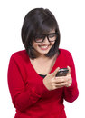 Pretty Asian girl holding cellphone Royalty Free Stock Photography