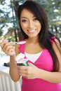 Pretty Asian Woman Eating Yogurt Royalty Free Stock Photography