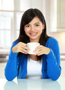 Pretty asian woman having a glass of tea Stock Images