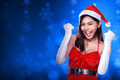 Pretty asian woman in santa claus costume holding cellphone