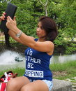 Pretty Asian woman takes selfie at the park Royalty Free Stock Photo