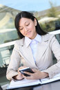 Pretty Asian Woman Texting at Work Royalty Free Stock Photo