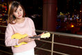 Pretty asian woman with ukelele beautiful malay female city lights in background Royalty Free Stock Images