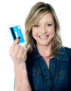 Pretty attractive lady showing credit card rich and smiling at camera Stock Photos