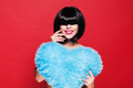 Pretty attractive smiling woman holding a blue plush heart waiting for valentine s day s love and feelings Stock Photos