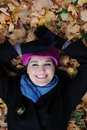 Pretty autumn girl relaxing outdoors in the forest Royalty Free Stock Images
