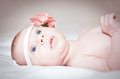 Pretty baby with flower headband Stock Photo