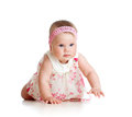 Pretty baby girl crawling on floor Stock Photography