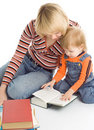 Pretty baby and mother read the books