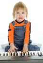 Pretty baby play piano Stock Image
