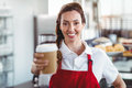 Pretty barista giving take-away cup Royalty Free Stock Photo